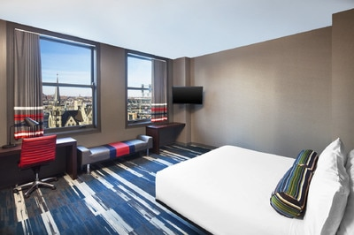A queen bed with a great view of downtown